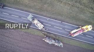 Poland: Stuck in the mud! US Army convoy grinds to a halt in roadside ditch