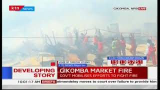 Firemen try to control the fire at Gikomba market