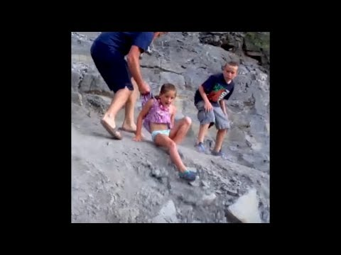 Dad Saves Kid From Falling Off A Cliff..