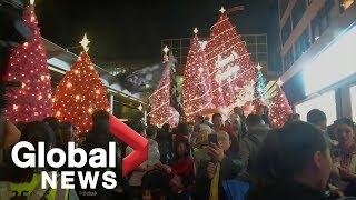Hong Kong protesters clash with police on Christmas Eve
