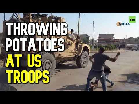 Kurds throw potatoes at US troops withdrawing from Syria