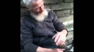 Homeless man    playing the spoons to Insomnia by Faithless