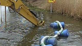 preview picture of video 'Dredging Channel wih Excavator and Dragflow pump'