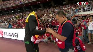Usain Bolt Receives Gift from Cameraman Who Crashed into Him
