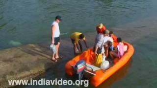 Visitors enjoying at Dona Paula beach, Goa