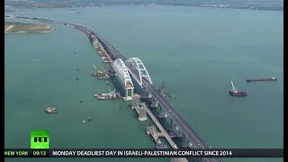 Russia connects mainland with Crimea, opening Europe's longest bridge