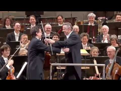 Orchestra plays Happy Birthday for the conductor