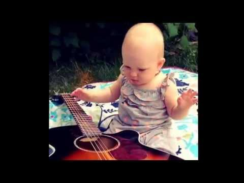 My little lady playing the guitar.  I am loving her sound...