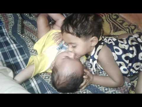 baby girl kiss her little brother