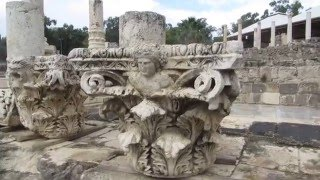 preview picture of video 'Beit She'an Israel:  a Corinthian capital of a pillar, bearing the head of the Greek god Dionysus'