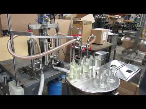4ounce Dual Piston Bottle filler sold by Filling Equipment Co., Inc.