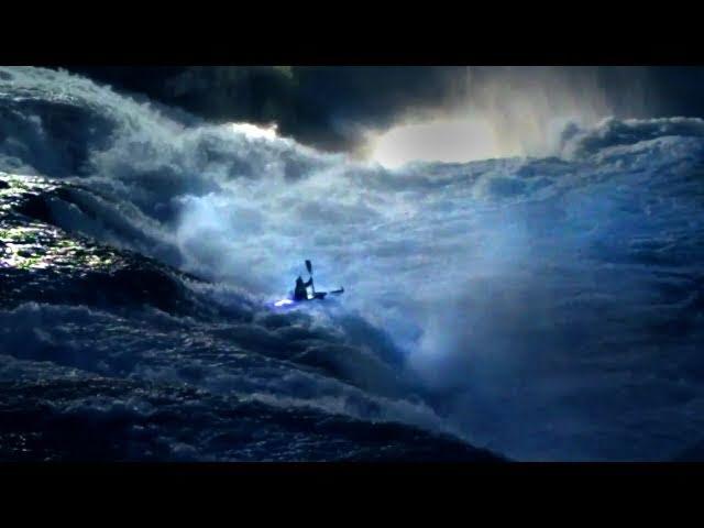 Nighttime kayaking down waterfalls - Rheinfall by Night