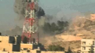 preview picture of video 'الباب_لحظة القاء طائرة لبرميل متفجر وانفجاره16/9/2012'