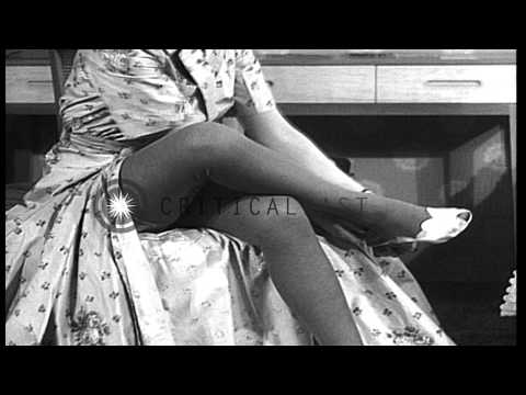 A woman wears a dress and stockings HD Stock Footage