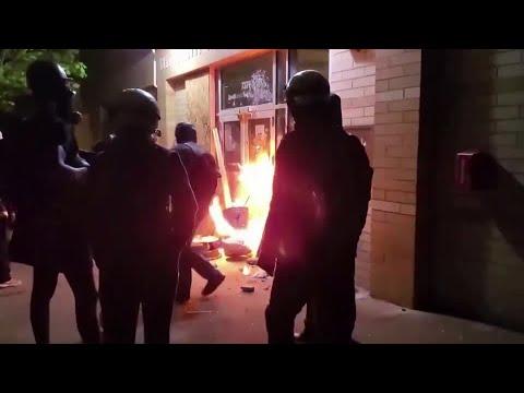 Portland protesters set fire outside precinct