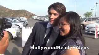 "Парни из сериала ""Дневники вампира"", Steven R. McQueen shows love to fan arriving at the 2014 Saturn Awards in Burbank"