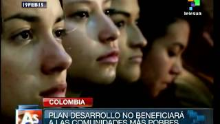 preview picture of video 'Colombia's development plan mean war in a country struggling for peace'