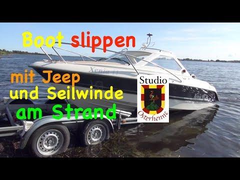 Unsere Tipps und Ratschläge beim slippen vom Sportboot Boot mit Jeep und Seilwinde am Strand Ostsee