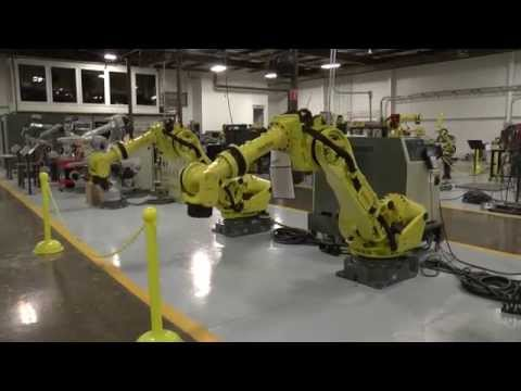 Two Fanuc R2000iA/200F's Move in Sync