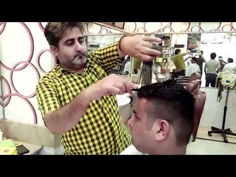 Пакистанец умеет стричь 15-ю ножницами одновременно