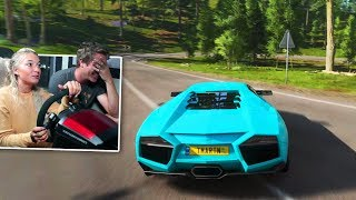 Girlfriend tries racing simulator..