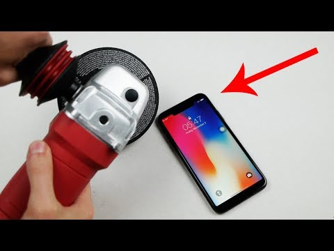 This Guy Is Annoyed By The iPhone X Notch So Much That He Removes It With A Blade
