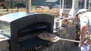 Wood pizza oven - Cooking pizza in an outdoor wood fired pizza oven