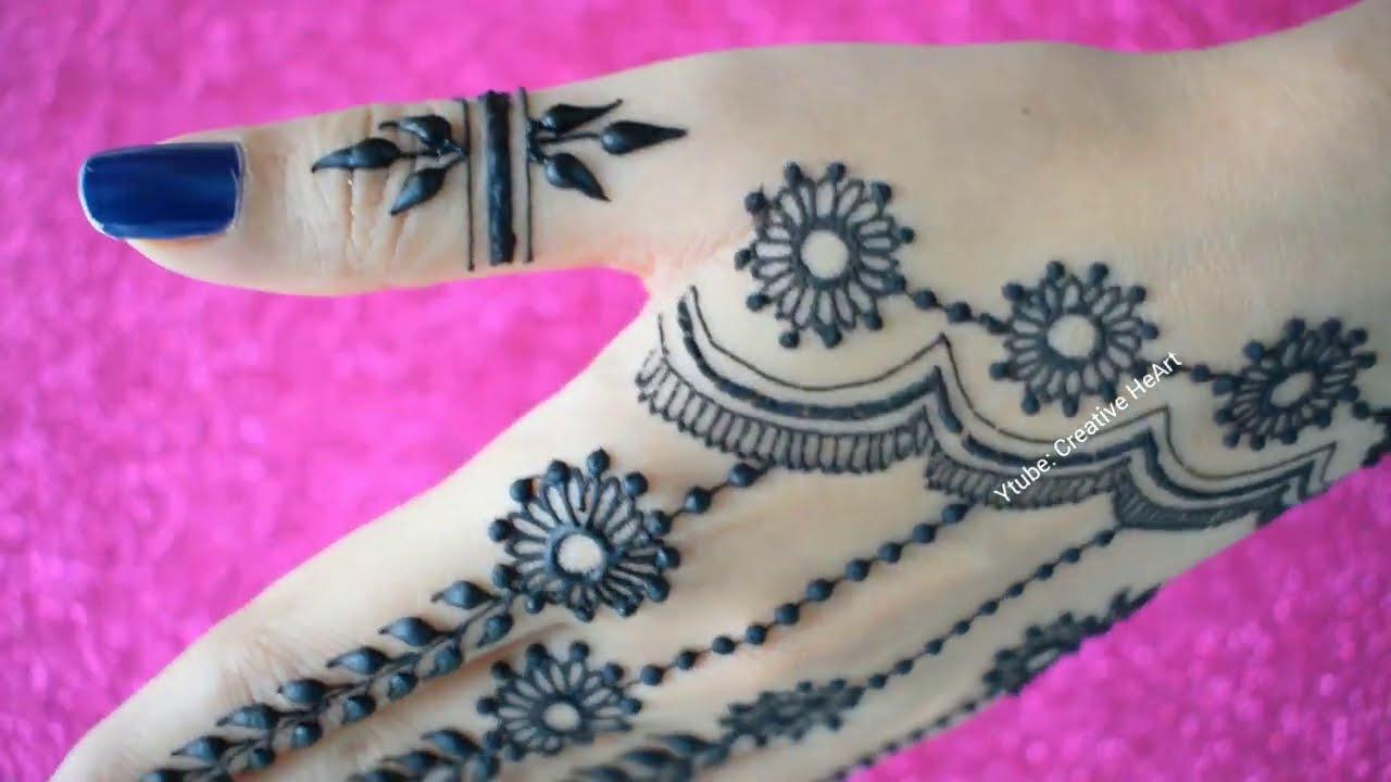 new stylish back hand mehndi design by creative heart