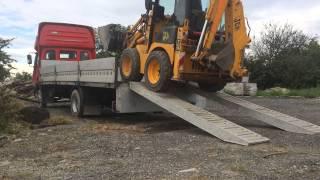 JCB 1CX load on  AVIA truck