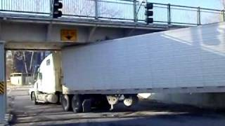 Truck get stuck under the underpass near the Walking Trail Bridge in Fredericton