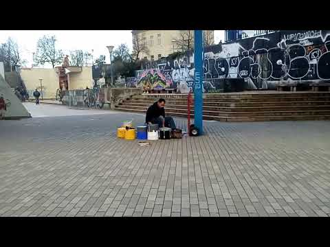 Man is playing on drums on Vltavská station