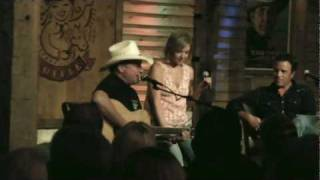 "Mark Chesnutt & Amber Digby singing, ""A Couple More Years"""