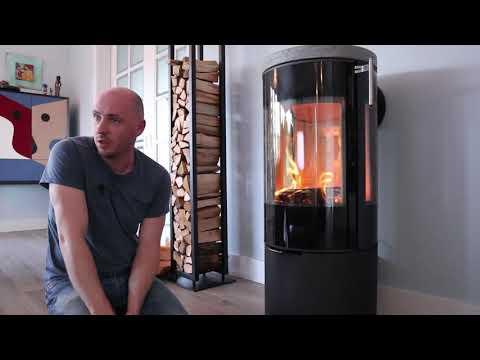 Датская печь в жилом доме. Модель Rais VIVA 100 с тремя стеклами и теплонакопительным камнем