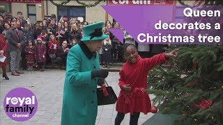 The Queen decorates a Christmas tree at a new national children's centre