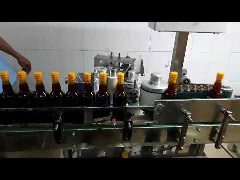 Máy dán nhãn bằng keo tự động