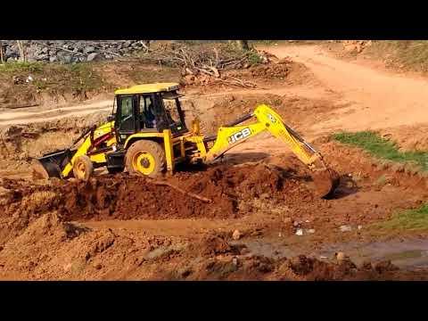 J C B , HITACHI Working and Loading Mud in Truck