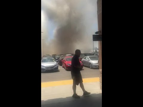Reports of several cars on fire at the Carmax