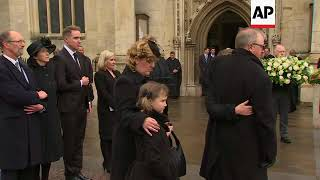 Mourners follow Hawking coffin out of church after funeral service