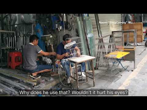 No need for goggles- he's got oil paper (welding in my neighborhood in Shenzhen)