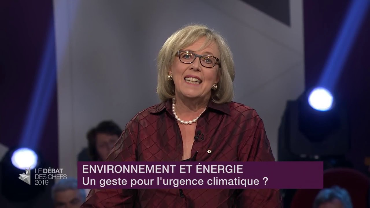 Elizabeth May answers a question about fighting climate change