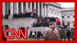 Pro-Trump rioters storm US Capitol steps