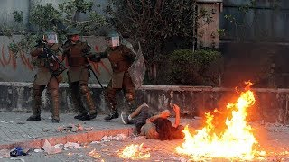 video: Furious Chileans clash with riot police as anti-government protests escalate