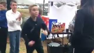 Kid trying to impress a girl by dancing