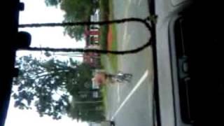 Man in thong riding his bike