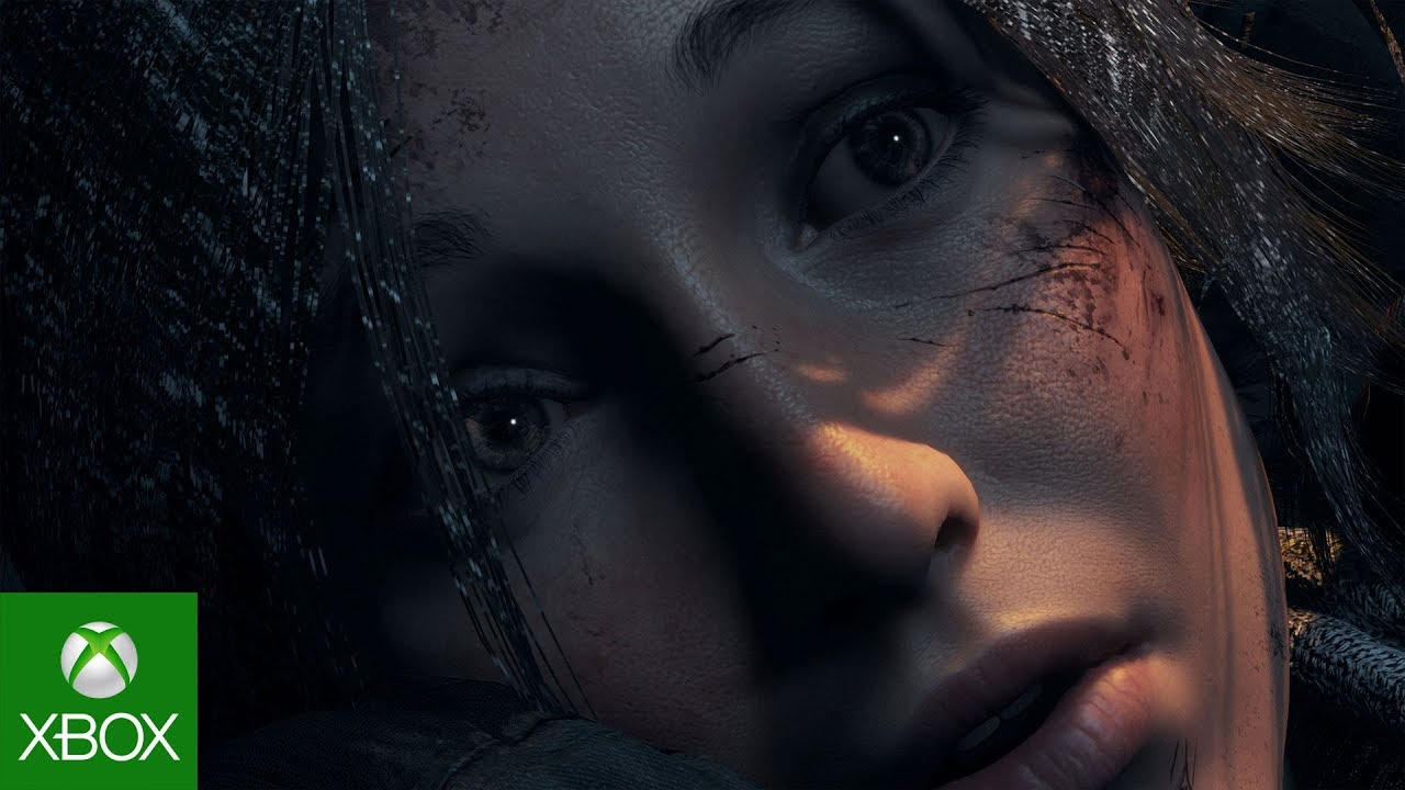 Close up of Lara Croft's face in shadow.