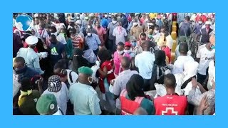 Mombasa residents receive free mask  and hand sanitizers at the
