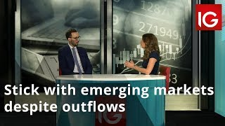 Stick with emerging markets despite outflows
