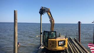Alford driving pilings for dock and a boat house
