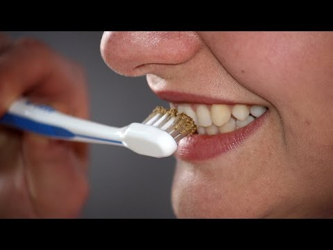 Brushing Your Teeth With Triphala Powder