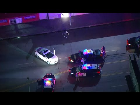 Law-breaking turned into breakdancing at the end of a Los Angeles vehicle pursuit. TV news helicopters were overhead Tuesday night when a suspect did a brief dance before being handcuffed. (March 19)